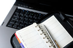 komunikat biznesowej pojęcia laptopa notatnik organizatora harmonogram Obraz Royalty Free