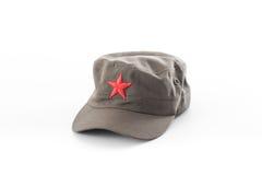 Komunistyczny kapelusz, czerwieni gwiazdy nakrętka na białym tle Fotografia Stock