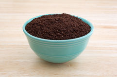 Kona coffee ground beans in a bowl Royalty Free Stock Image