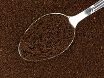 Kona coffee ground beans with a spoon Stock Images