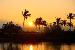 Kona hawaii over water overwater bungalows. Bungalow sunset sunrise palms stock image