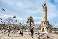 Konak Square, walking ordinary people and doves royalty free stock photography