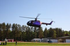 Aircraft - Violet helicopter Russian Cup royalty free stock images