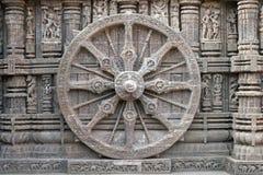 Konark Wheel. Ornately carved stone wheel on the ancient Surya Hindu Temple at Konark, Orissa, India. 13th Century AD Stock Images