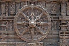 Konark Wheel. Ornately carved stone wheel on the ancient Surya Hindu Temple at Konark, Orissa, India. 13th Century AD Stock Photography