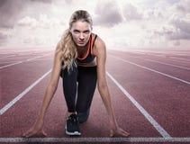 Koncentrerad löpare i startande position Fotografering för Bildbyråer