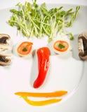 koncepcja jedzenie twarzy zdjęcia royalty free