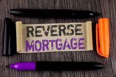 Konceptualna ręki writing seansu odwrotności hipoteka Biznesowego fotografia teksta właściciela domu emerytura opci miarowej zapł Zdjęcie Royalty Free
