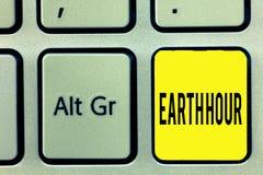 Konceptualna ręki writing seansu ziemi godzina Biznesowego fotografia teksta Globalny ruch wezwanie dla wielkiej akci na klimacie obrazy royalty free