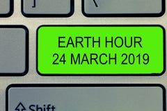 Konceptualna ręki writing seansu ziemi godzina 24 Marzec 2019 Biznesowy fotografia tekst Świętuje trwałości Save planeta fotografia stock