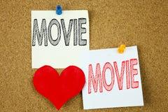Konceptualna ręki writing teksta podpisu inspiracja pokazuje filmu pojęcie dla rozrywka filmu filmu i miłości pisać na kleistym n zdjęcia stock