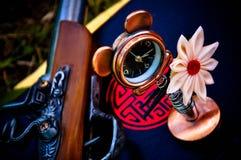 Konceptualny Florwer czasu zegaru pistolet Zdjęcia Stock