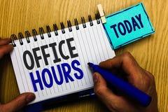 Konceptualny ręki writing pokazuje Biurowe godziny Biznesowa fotografia pokazuje godziny który normalnie prowadzący Pracujący Tim obrazy stock