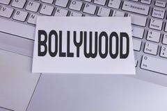 Konceptualny ręki writing pokazuje Bollywood Biznesowa fotografia pokazuje Indiańskiego kino źródło pisać na Białym Stic rozrywka fotografia royalty free
