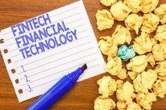 Konceptualny ręki writing pokazuje Fintech Pieniężną technologię Biznesowy fotografia tekst zapewnia Monetarnej usługa używać Now obraz stock
