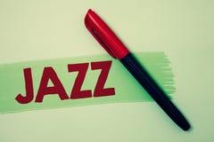 Konceptualny ręki writing pokazuje jazz Biznesowa fotografia pokazuje typ muzyka czarnego Amerykańskiego początku Muzykalnego gat Fotografia Stock