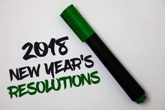 Konceptualny ręki writing pokazuje 2018 nowy rok 'S postanowienia Biznesowa fotografia teksta lista cele lub cele być dokonującym Zdjęcia Royalty Free