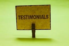 Konceptualny ręki writing pokazuje Testimonials Biznesowych fotografia teksta klientów poparcia oświadczenia formalny doświadczen obraz stock
