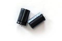 Kondensator som isoleras på vit bakgrund Fotografering för Bildbyråer
