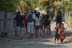 KONDEY, MALDIVES - MARCH, 12 2014 - Childrens and People in the street before evening pray time Royalty Free Stock Images
