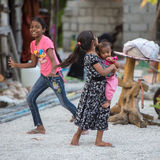 KONDEY, MALDIVES - MARCH, 12 2014 - Childrens and People in the street before evening pray time Stock Image