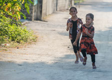KONDEY, MALDIVES - MARCH, 12 2014 - Childrens and People in the street before evening pray time Royalty Free Stock Photos