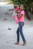 KONDEY, MALDIVES - MARCH, 12 2014 - Childrens and People in the street before evening pray time Stock Photos