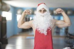 Kondition Santa Claus som poserar mycket starkt Arkivbilder