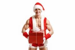 Kondition Santa Claus som rymmer en röd ask Royaltyfri Bild