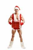 Kondition Santa Claus som rymmer en röd ask Royaltyfri Foto