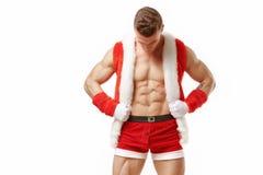 Kondition Santa Claus som visar sex packeabs Fotografering för Bildbyråer