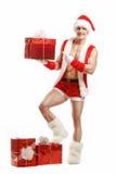 Kondition Santa Claus visar en röd ask Royaltyfri Foto
