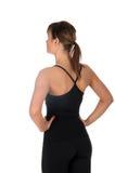 Konditionkvinna i svart sportkläder som isoleras på vit Royaltyfri Foto