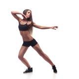 Konditionkvinna som övar aerobics för dansgrupp Arkivbild