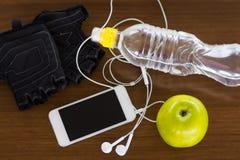 Konditionutrustning och sund näring Arkivfoton