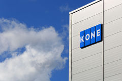 KONE Building with Signage and Blue Sky Clouds Stock Image