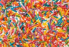 Konfektkonfettier för matgarneringbakgrund Royaltyfri Foto