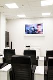 Konferensutbildningsrum med video Arkivfoto