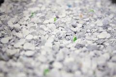 Konfettier från hålstansmaskin Fotografering för Bildbyråer