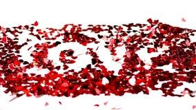 Konfettier som tillsammans blåsas för att stava förälskelse arkivfilmer