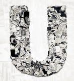 Konfettis des Zeitungsbuchstaben U Lizenzfreie Stockfotografie
