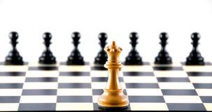 Konfrontation gegen Pfandgegenstände. Schach. Lizenzfreie Stockfotografie
