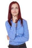 Konfuse junge Geschäftsfrau, halten ihr Kinn an Stockbilder