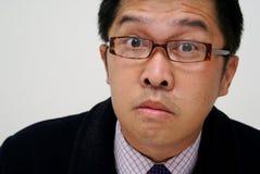 Konfuser asiatischer Geschäftsmann Lizenzfreies Stockbild