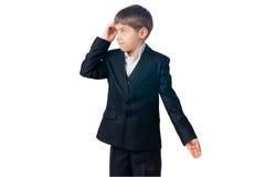 Konfuser Junge, der seinen Kopf seitlich schaut löscht Stockfotos