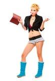 Konfuses modernes junges Mädchen mit Buch in der Hand Stockfotos