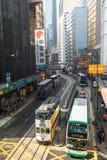 Kong cityscapesikt med berömda spårvagnar och bussar royaltyfria foton