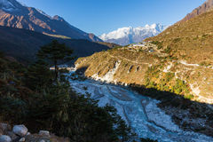 Kongde Ri mountain snow peaks ridge above Pangboche village, Nep. Kongde Ri mountain snow peaks ridge above Pangboche resort village Imja Khola river stream Royalty Free Stock Photo