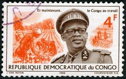 KONGOFLODEN - 1966: visar Joseph Desire Mobutu 1930-1996, Sese Seko Kuku Ngbendu Wa Za Banga, Pyrethrumskörden, presidenten Congo arkivfoto