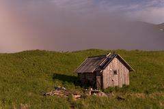 Koni peninsula. The coast of the Sea of Okhotsk. Koni peninsula. Magadan region. Lonely hut Royalty Free Stock Photo